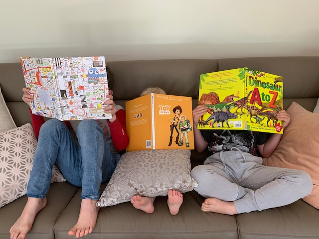 An image of children reading picture books